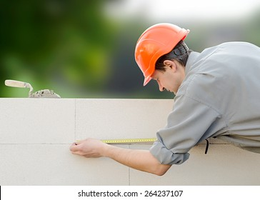 Builder erects a wall