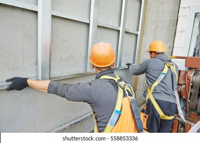 builder at facade construction work