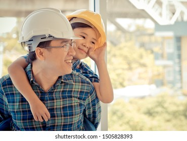 Builder father is carrying his son on his back for father son togetherness and family bond concept. Parenting love concept.