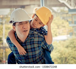 Builder father is carrying his son on his back for father son success bond and togetherness concept