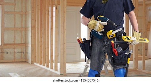 Builder handyman with drill tools.
