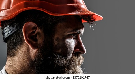 Builder in hard hat, foreman or repairman in the helmet. Construction worker in hardhat. Portrait mechanical worker. Bearded man in suit with construction helmet. Portrait of handsome engineer.