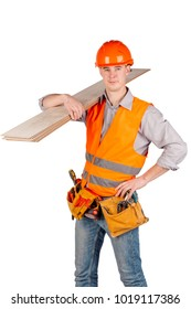 builder in a helmet holding floorboards and looking at camera over white wall background. repair, construction, building, people and maintenance concept.