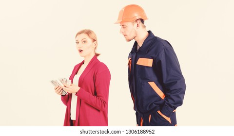 Builder in helmet looks at woman with busy face counting money, isolated on white background. Repairer, builder wants salary for work. Payment concept. Customer deceives repairman, builder, mechanic.