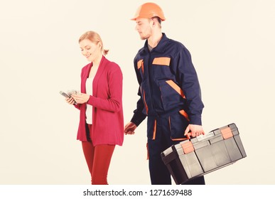 Builder in helmet looks at woman counting money, isolated on white background. Customer deceives repairman, builder, mechanic with toolbox. Repairer, builder wants salary for work. Payment concept.