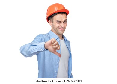 Builder in a helmet shows thumb down, isolated background, toned