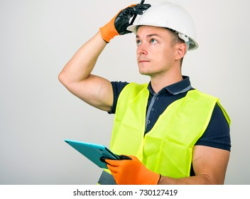 Builder in a helmet and vest