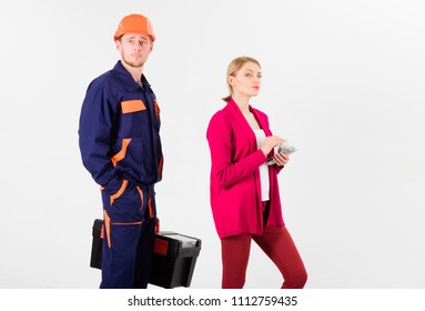 Builder in helmet waits while woman with busy face counting money, isolated on white background. Repairer, builder wants salary for work. Deceive concept. Customer deceives builder, builder, mechanic.
