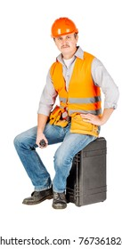 builder in a helmet with with walkie talkie or radio over white wall background. repair, construction, building, people and maintenance concept.