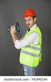 Builder holding a drill like a gun