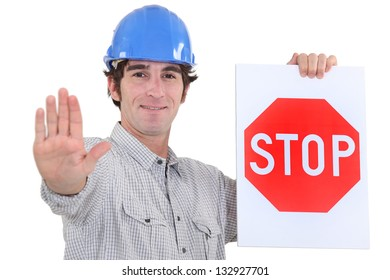 Builder holding stop sign