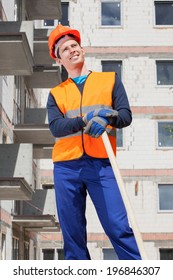 Builder keeping a spade at building area