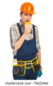 Builder man eating sandwich in a break isolated on white background