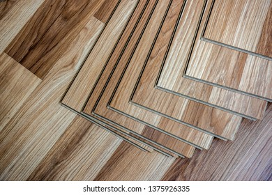 The builder, man is engaged in laying laminate in the room - repair and finishing work. seamless wood floor texture, hardwood