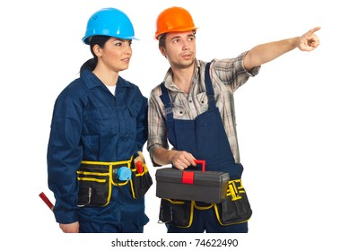 Builder man pointing away and showing something to his colleague woman isolated on white background
