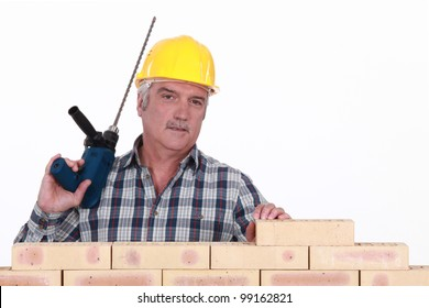 Builder with a masonry drill