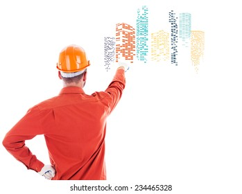 Builder pointing at graphic city icon with skyscrapers