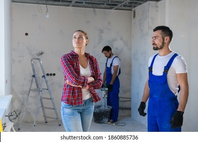 The builder shows the client the renovation of the apartment. She is unhappy