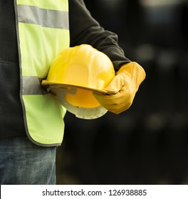 builder with small computer and gloves