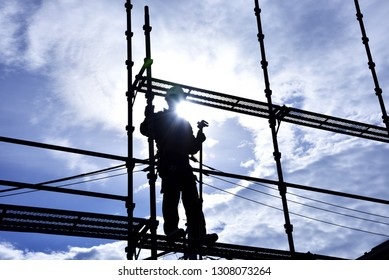 "the builder ""steeplejack"" assembling the scaffold at the housing construction site : Framework construction"