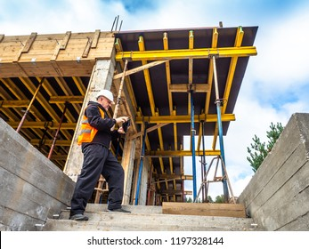 The builder is studying the documents on the construction of the building. Construction works. A man studies the construction data. Inspection at the construction site.