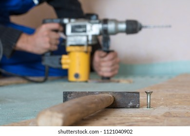 Builder, tools for construction, nails, moto, drill