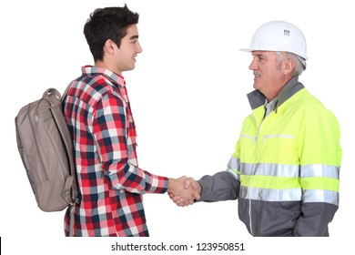 Builder welcoming apprentice