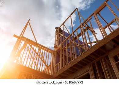 builder at work with wooden roof construction Wood Building frame