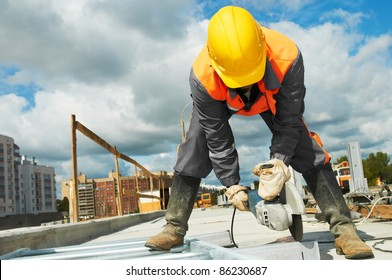 Builder worker with grinder machine cutting metal parts at construction site