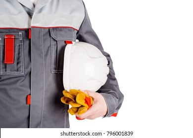 Builder worker with orange helmet in hands isolated on white background.