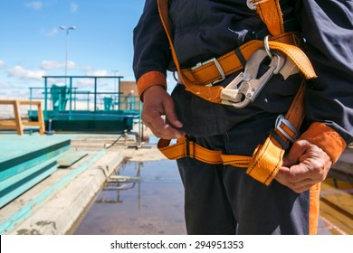 Builder Worker in safety protective equipment on bridge construction