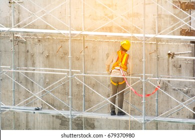 Builder Worker in safety protective equipment on pipe rack construction site .copy space.