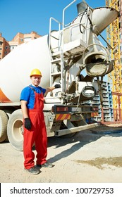 builder worker in uniform in front of concrete mixer truck at construction site