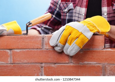 Builder working on a brick wall