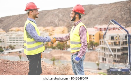 Builders on residential construction site making a deal - Happy workers are satisfied of their plan - Dealing, real estate, engineer, industrial and building houses concept