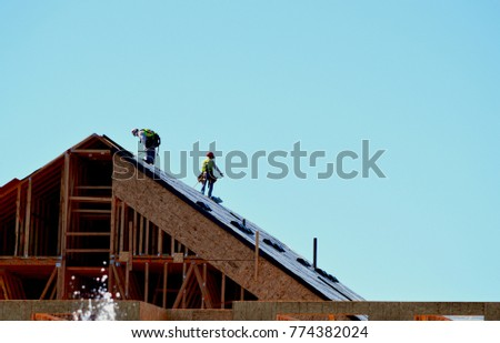 builders on the roof