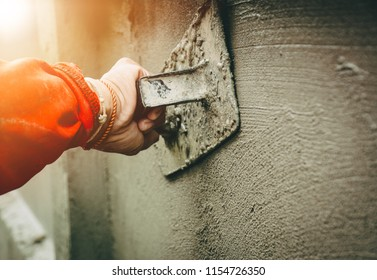 Builders are plastering the walls of the house with neatness. Have professional skills and high working experience. Concept of construction business.