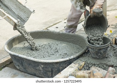 Builders are pouring ready-mixed concrete. Pouring concrete into the construction of the house.