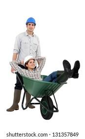 Builders and wheelbarrow