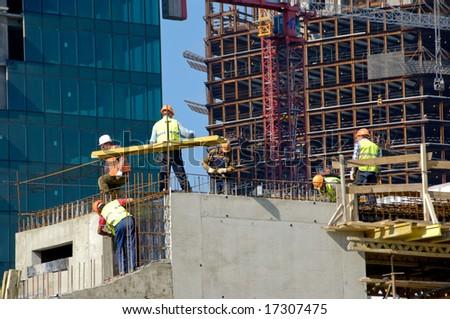 Builders Work On Skyscraper Construction