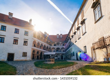 Building architecture and courtyard of Ptuj Castle in Slovenia. Facade of Ptujski grad in Slovenija. Sunset