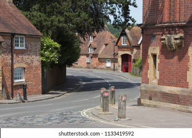 Building architecture in the historic and beautiful Beaulieu village in the New Forest area of Hampshire, England UK showing ancient brick and timber construction techniques with herringbone pattern