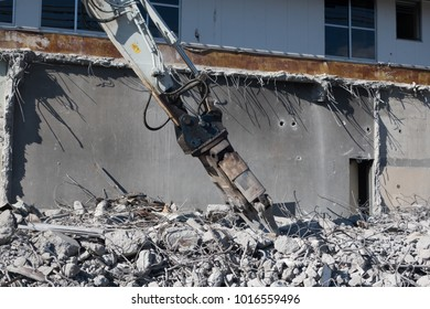 Building Being Demolished by Machinery