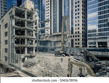 Building being demolished in an urban environment