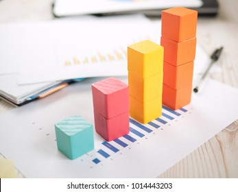building blocks with bar chart graph