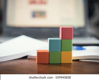 building blocks cubes against blur laptop background