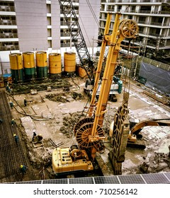 Building blocks with large machines.