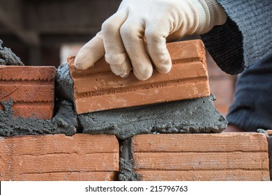 Building brick block wall on construction plant