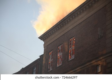 A building is burning and smoke is all over the place. Firefighters are trying to control the fire. No one was hurt.