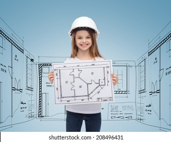 building, childhood, developing, construction and architecture concept - smiling little girl in white helmet showing blueprint